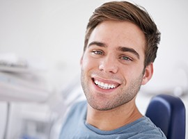 Man in dental chair with flawless smile