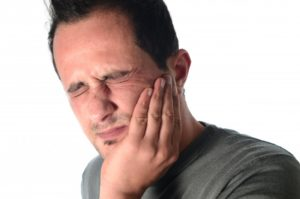 man frowning from dental pain
